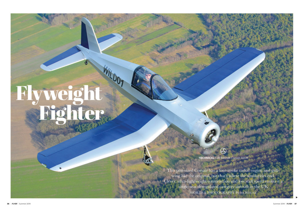 Photo looking down on the new ultralight Corsair aircraft in flight.