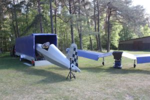 Photo of the Corsair ultralight aircraft being derigged for trailering.